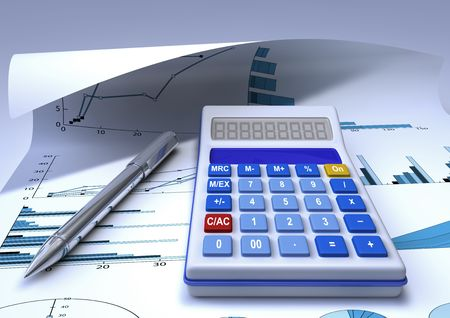 a calculator and a chromed pen on a finacial chart sheet photo