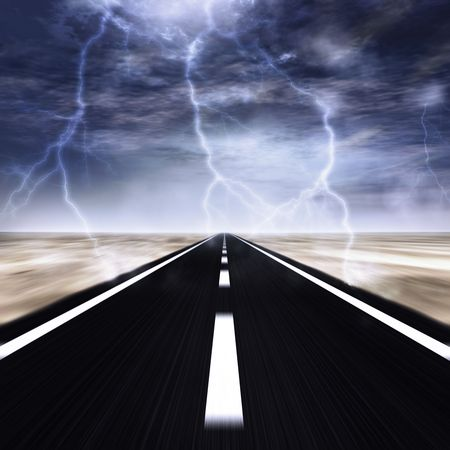 lightnings: road with a thunder storm over it Stock Photo
