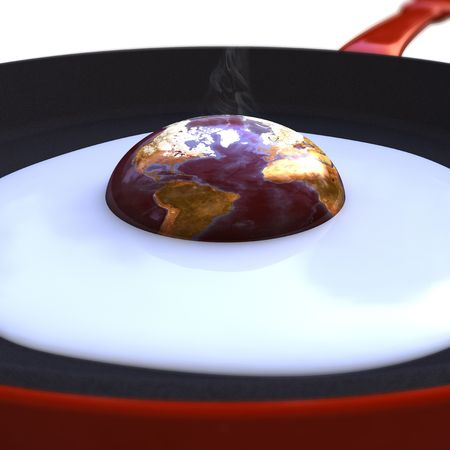 overheating: Earth egg in a frying pan isolated on white background