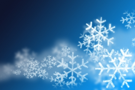 wintry: snowflakes over a blue background Stock Photo