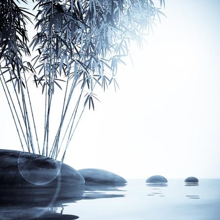 Bamboe en stenen op het water