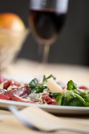 carpaccio: carpaccio with rucola, parmesan cheese and mayonnaise sauce Stock Photo