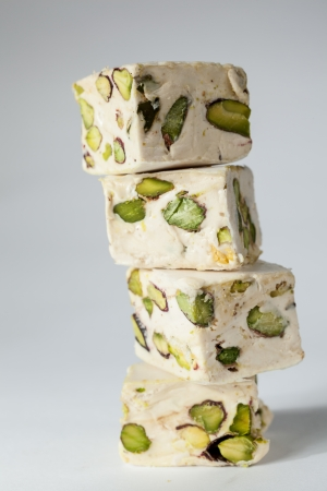 Soft turron cubes with pistachios photo