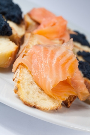 Appetizer of crostini with salmon and caviar photo