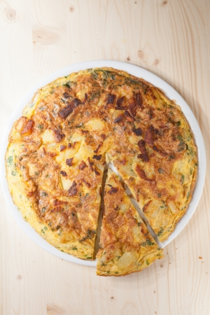 Frittata with potatoes, Parmesan and parsley photo