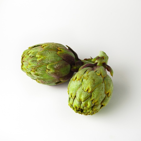 Green artichokes on white background photo