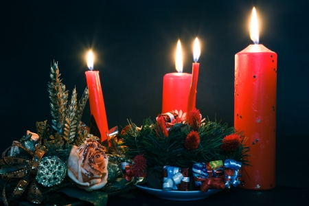 Christmas wreath with redcandles photo