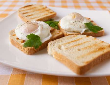 british foods: Poached eggs on white plate