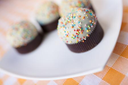 cup cakes op tartan tafelkleed