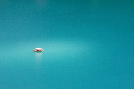 Lonely boat at Bled lake, Slovenia.
