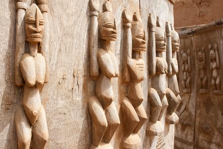 Wood sculptures near the Bandiagara Escarpment, Mali (Africa).