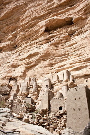 bisected: The principal Dogon area is bisected by the Bandiagara Escarpment. The Dogon are best known for their mythology, their mask dances, wooden sculpture and their architecture. Stock Photo
