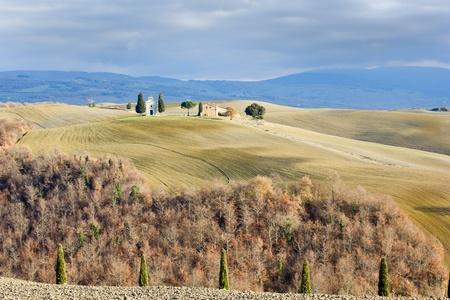 Tuscan landscape in winter, Val d'Orcia (Italy). In the background the little church Cappella della Madonna di Vitaletat,. Stock Photo - 12026246