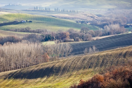 Közötti időszakban mezőgazdasági földterületek Pienza és San Quirico d'Orcia (Toscana, Olaszország). Stock fotó