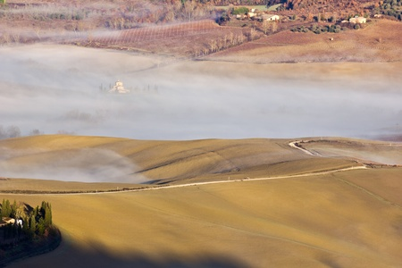 Tuscan landscape in the fog, Montepulciano (Italy).  photo