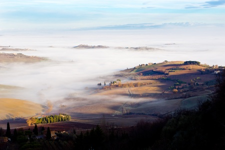 Tuscan landscape in the fog, Montepulciano (Italy).  Stock Photo - 12124716