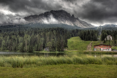 lake misurina: Clouds over lake Misurina, Dolomites, Italy  Editorial