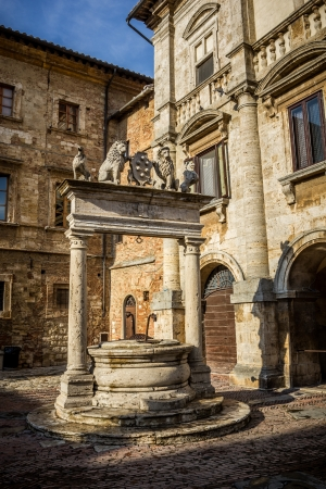 lintels: Ancient well on Piazza Grande square in Montepulciano, Tuscany, Italy