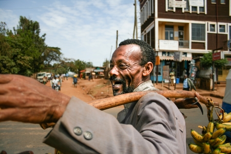 Happy hawker selling bananas on the street in Dilla on December 23, 2008, in Dilla, Ethiopia