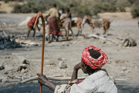 Elder rests and observes workers to the salt mine in the former volcano crater on December 24, 2008, in El Sod, Ethiopia