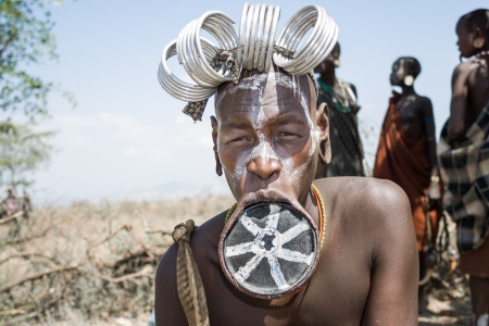 Woman of the Mursi ethnic group shows her typical lip plate, Debub Omo, Ethiopia  The Mursi are an ethnic group that inhabits southwestern Ethiopia, Africa