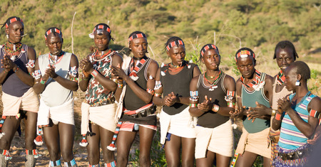 Young men of the ethnic Hamer group dancing in the traditional leaping ceremony  the jumping of bulls  on December 27, 2008 in Dimeka, Ethiopia
