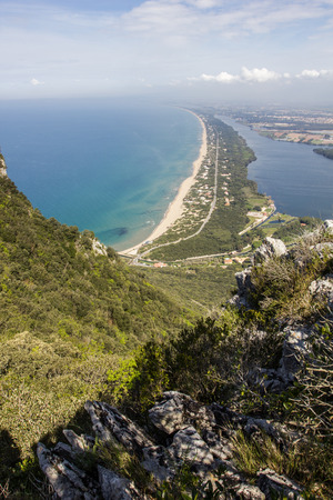 View of coastal sand strip and Lake Paola from the limestone cliffs of the Mount Circeo, Lazio, Italy