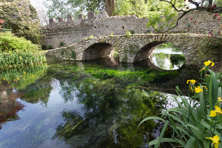 Ancient bridle on the crystalline wather in the Garden of Ninfa in the province of Latina, Italy, Europe. Banque d'images