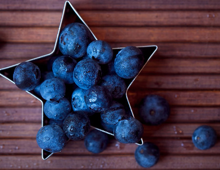 wood cutter: blueberries Stock Photo