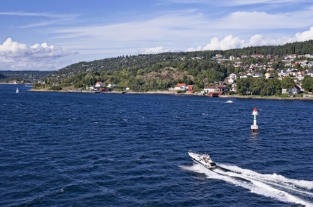 Norwegian coast with motorboat photo