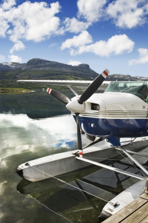 hydroplane: Seaplane in norway lake with mountain background