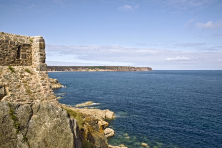 heathland: Ancient stronghold Fort la Latte in France by coast