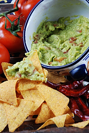 the typical mexican food with guacamole and nachos