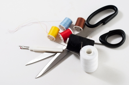 sewing set against white background with colored objects Stock Photo
