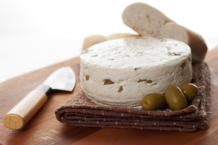 chees: homemade chees with olives against white background Stock Photo