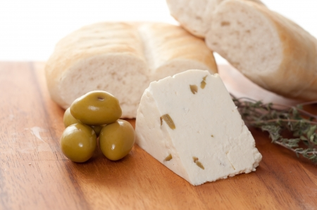 homemade chees with olives against white background Stock Photo