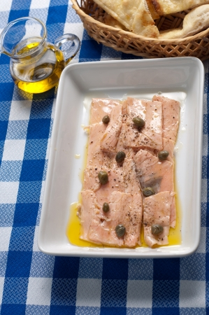 marinated salmon with cappers and olive oil photo