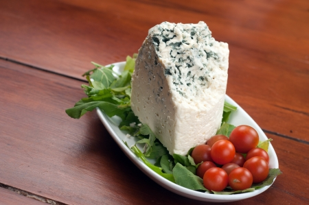 the delicious gorgonzola on a brown board Stock Photo