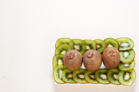the tasty and vitaminic kiwi fruit against a white background