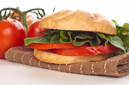 tasty and delicious sandwich with tomatoes and arugula