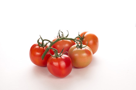 red fresh tomatoes on a white background