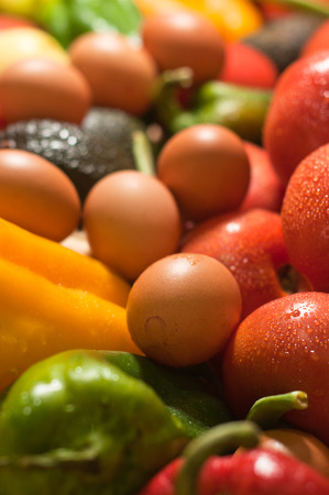 pink eggs and fresh colored vegetables Stock Photo