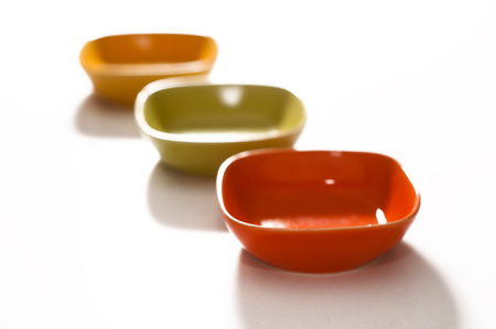 colored saucers on a white background