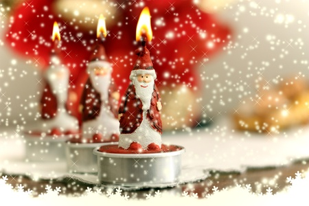 Candles depicting Santa Stock Photo