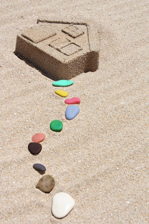 House of sand and colored stones