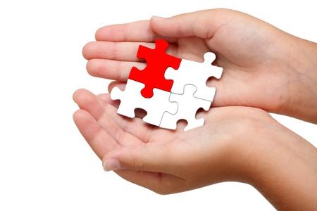 Puzzle in der Handfläche von Ihrer Hand Standard-Bild