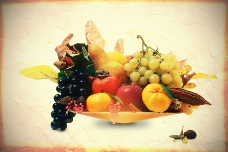 Basket of fruit and autumn leaves photo