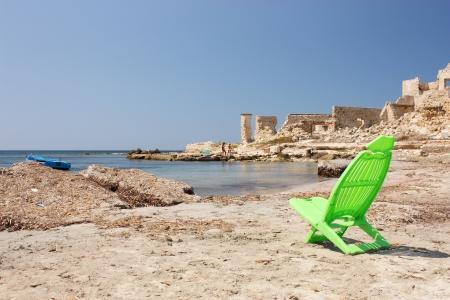 Natural beach and deckchairs