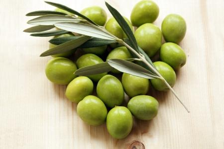 Olive green heart-shaped Stock Photo