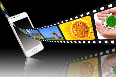 From a smartphone comes out with a film image Stock Photo